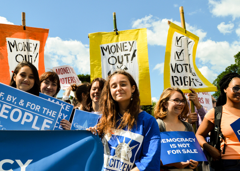 Image of young activists at a rally for driving money out of politics